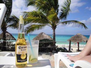 Enjoy Nachi Cocom's Sand, Sun and Sea and a cold Cerveza at Nachi Cocom Beach Club in Cozumel